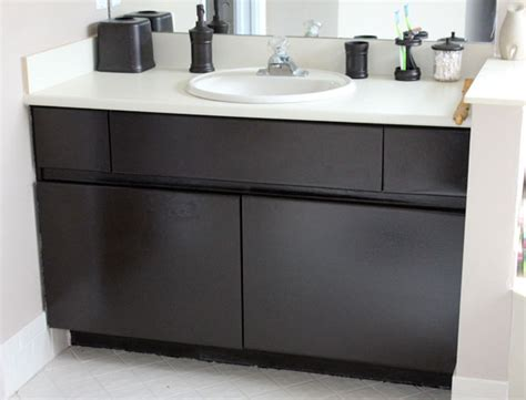 can you paint laminate cabinets diy inexpensive bathroom cabinet makeover