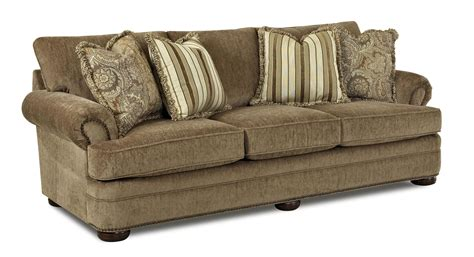 traditional settee tolbert traditional sofa with rolled arms and fringe