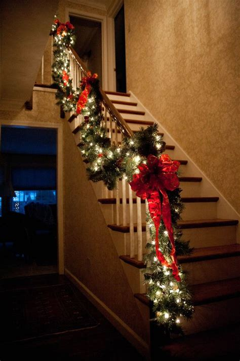 traditional staircase garland by the perfect affair