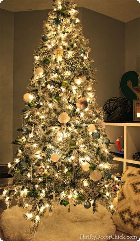 a blue and green flocked tree christmastree christmas