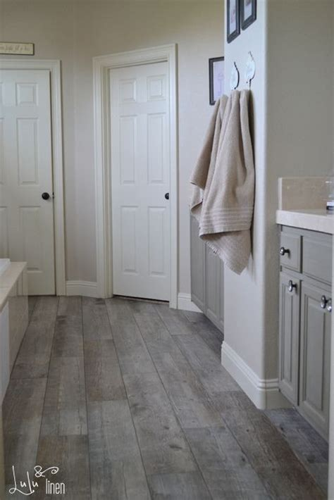 ash cabinets and porcelain floor on