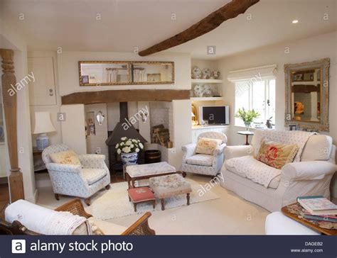 White Living Room Arm Chairs by White Sofa And Pale Blue White Armchairs Around Fireplace