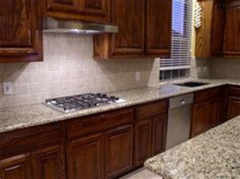 picture of kitchen cabinet backsplash with giallo ornamental granite giallo 4188