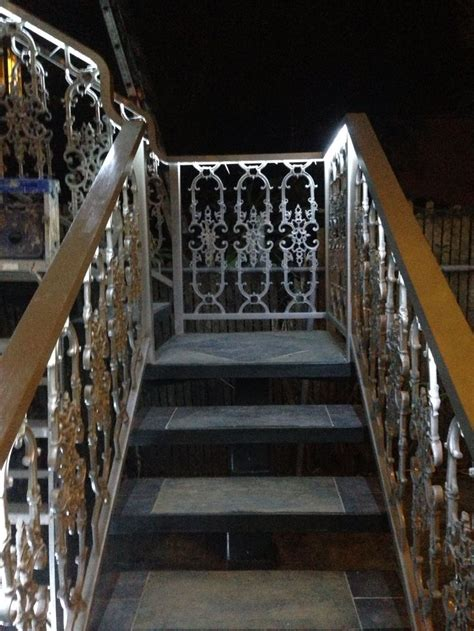 wrought iron railing slate stairs rope lighting