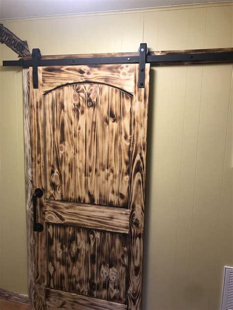 torched pine barn door wood barn door barn door torch wood