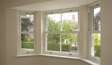 timber effect sliding sash windows  dorset premier windows