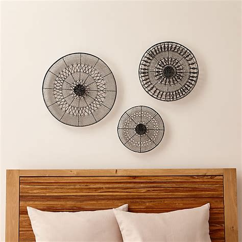 The beautiful palm leaf comes in a set of 3 and looks great on any wall. Intricate Circle Metal Wall Art 3-Piece Set | Crate and Barrel