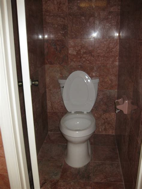remodeling bathrooms ideas reddish tiled bathroom toilet area remodeling ideas