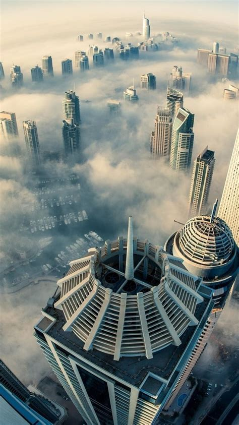 dubai cities cityscapes clouds skyscrapers wallpaper