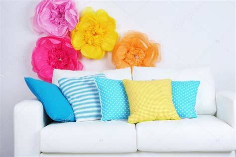 Colorful Sofa Pillows by White Sofa With Colorful Pillows In Room On Bright Wall