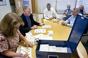 Canvassing board reviews ballot signatures for middle ...