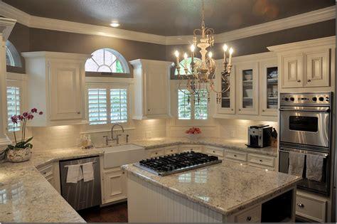 cream backsplash with white cabinets dark wood floor white gray granite white cabinets