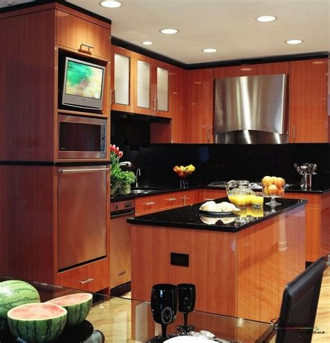 brown kitchen cabinets 25 best ideas about tv in kitchen on a tv 6421