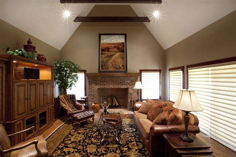 Living Room Colour Ideas Brown Sofa by Country Living Room With Exposed Beam By Customhomegroup