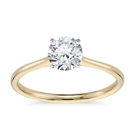 petite solitaire engagement ring in 18k yellow gold blue