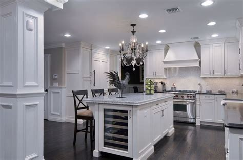 clean white cabinetry    wine cooler built