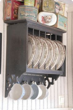 love love love this plate rack!!   the cupboards w/ glass