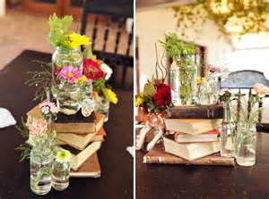 vintage bottles wedding centerpieces with books and