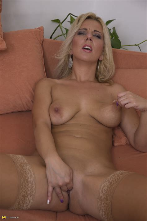 Nude Pictures Of Tanned Blonde Pleasing Pussy With Dildo