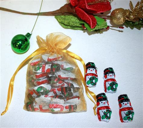 christmas gift bag filled with santa or snowman madelaine