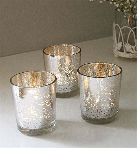 set of two silvered tea light holders by red lilly