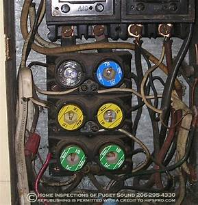 Overloaded fuse box, multiple tapping and knob and tube wiring, Seattle Area Home Inspection