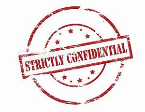 Rubber stamp with text strictly confidential inside ...