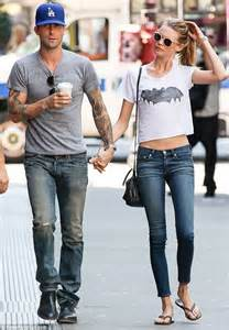 Adam Levine reveals his muscular figure as he dashes ...