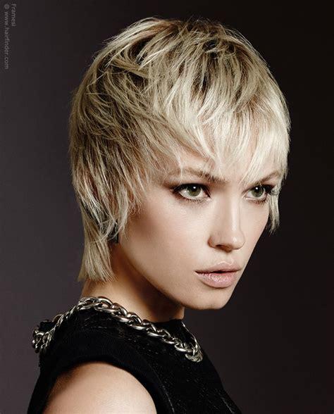 short blonde hair  falls   surround  face