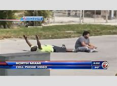 Police shoot unarmed black man on ground with his hands in