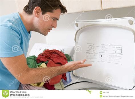 doing laundry by man doing laundry stock photos image 6881773