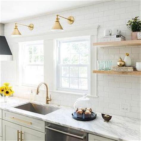 kitchen stove shelves with brass sconces transitional kitchen benjamin