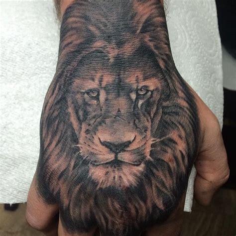 adampekrart lion hand tattoo  mark lion