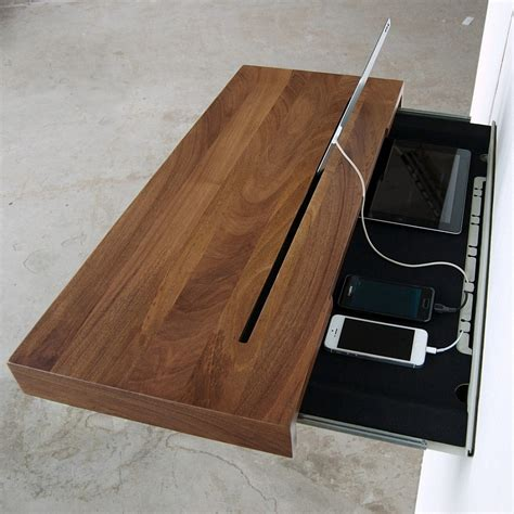 wall mounted drawer stage offers a discreet charging shelf for your