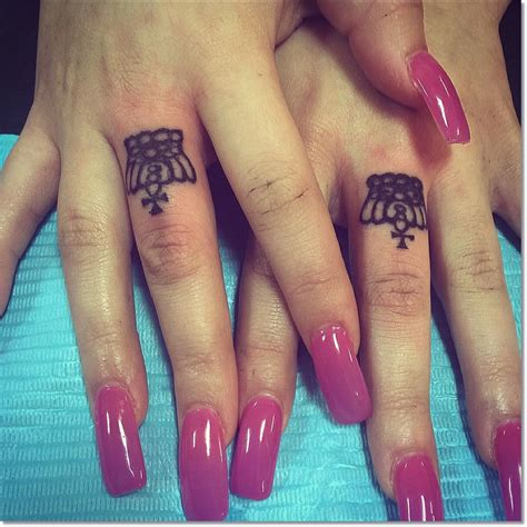 beautiful crown tattoos  fingers  couple