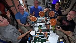 nasa astronauts throw zero gravity pizza for space