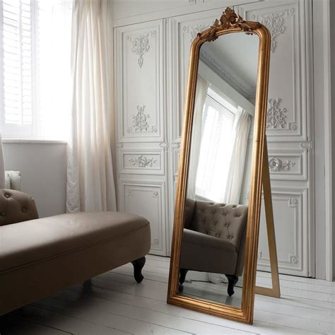 eye  design decorate  large ornate leaning mirrors