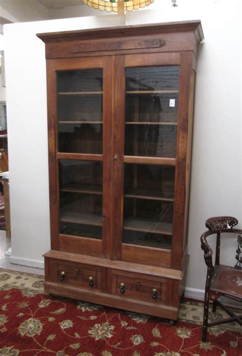 bookshelf with cabinet base victorian walnut cabinet bookcase on base america