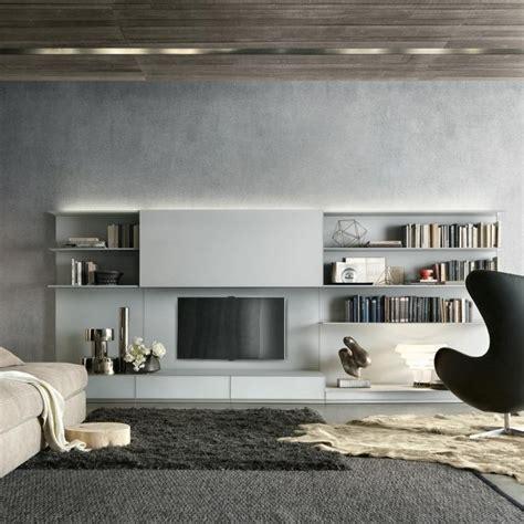 #wohnwand #design #designer #designwohnwand #designerwohnwand #lowboard #tvlowboard #tv #fernseher. Moderne Wohnwand mit LED Beleuchtung - 55 Ideen