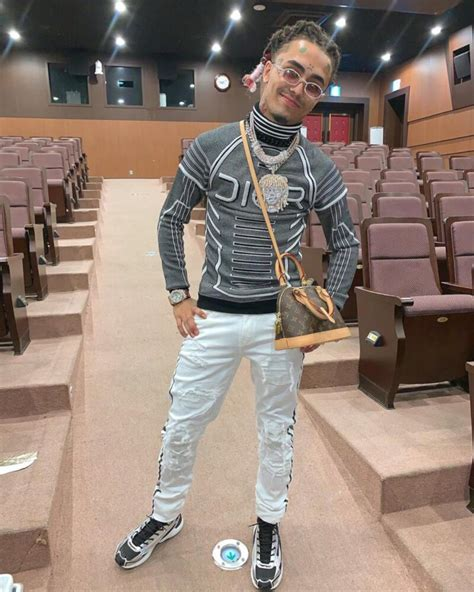 lil pump poses   fw dior  sorayama sweater amiri louis vuitton