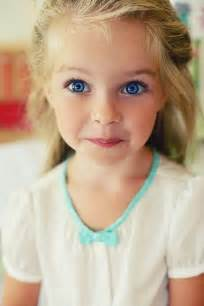 Cute Little Blonde Girl with Blue Eyes