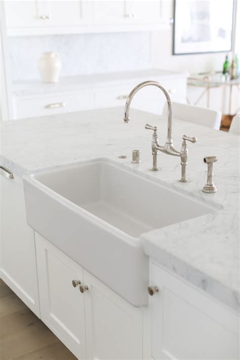 kitchen faucets for farm sinks california house with crisp white coastal interiors