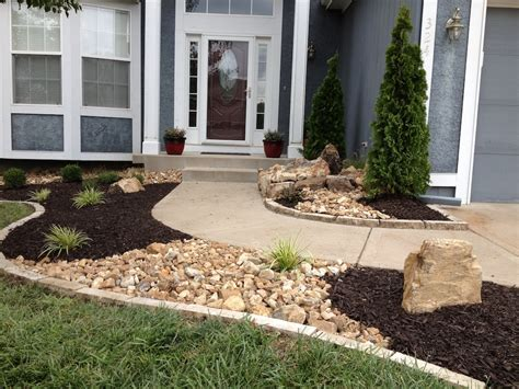 using rocks in landscape design new landscape with stone edging dry river creeks and a bubbling rock water feature in raymore