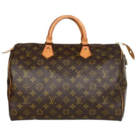 louis vuitton vtg  lv monogram canvas speedy  top handle bag  lock  key  sale