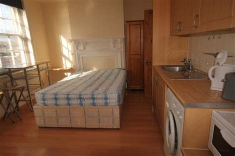 flat  double bed  middle   kitchen