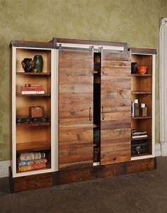 Barn door sliding wall unit pinterest shelves on the for Barnwood pocket door