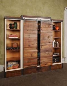 Barn door sliding wall unit pinterest shelves on the for Barnwood pocket door