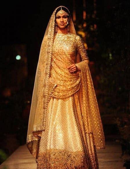 indian wedding   gold lehenga