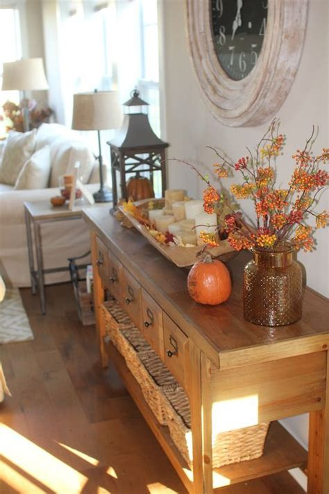 Table Decorating Ideas Candles Apples Autumn Indoor Outdoor Atmosphere 650x325 by 20 Essential Autumn Interior Decorating Tips