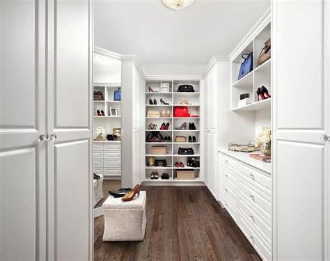walk in closet with trellis wallpaper transitional closet